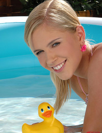 Tracy Gold fucks and humps herself a lucky ducky in the pool